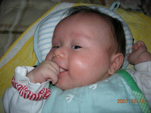 Rikuto, eating his own hand.